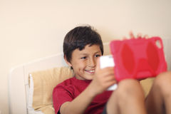 Young boy making selfie pictures Stock Image