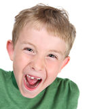 Young boy making a silly face. A young boy laughs after he just lost one of his front teeth Stock Images