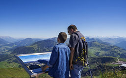 Young boy and man exploring the Alps mountains in Tirol Royalty Free Stock Image