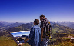 Young boy and man exploring the Alps mountains in Tirol Royalty Free Stock Photos