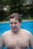 Young boy, man in swimming pool Royalty Free Stock Photos