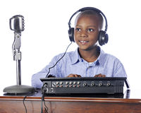 Young Boy Manning the Soundboard Royalty Free Stock Photos