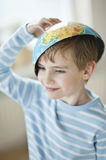 Young boy with map bowl on his head Stock Images
