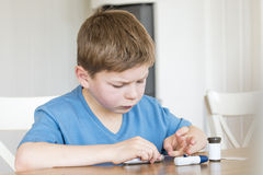 Young boy measuring blood sugar Stock Photos