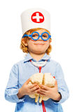 Young boy with medical cap and cerebrum dummy. Young boy with medical cap and toy glasses, holding cerebrum dummy, isolated on white stock photos