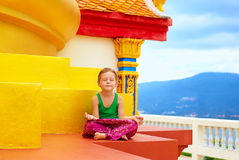 Young boy meditating at buddhist temple Royalty Free Stock Images