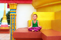 Young boy meditating at buddhist temple Royalty Free Stock Photography