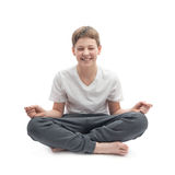 Young boy meditating Stock Photo
