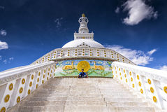 Young boy meditating in front of Shanti Stupa in Leh, India Royalty Free Stock Photos