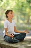 Young boy meditating Royalty Free Stock Images