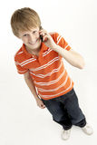 Young Boy With Mobile Phone royalty free stock image
