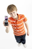Young Boy With Mobile Phone Stock Photography