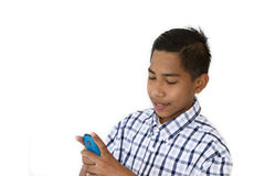 Young boy with a mobile phone Stock Photos