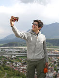 Young boy with modern smartphone makes a selfie Royalty Free Stock Image