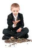 Young boy with money. Boy in a business suit, holds money in hands, isolated on white Stock Images
