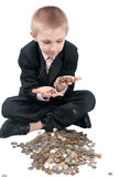 Young boy with money. Boy in a business suit, holds money in hands, isolated on white Royalty Free Stock Image
