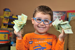 Young boy with money Royalty Free Stock Images