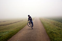 Young boy with mountain bike on tour Stock Photo