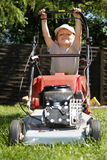 Young boy mowing grass Royalty Free Stock Photo