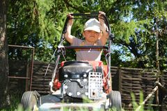 Young boy mowing grass Royalty Free Stock Images