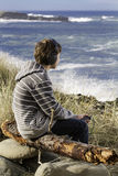 Young boy music. Young surfer listening to music down at the beach, enjoying life Royalty Free Stock Photos