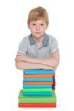 Young boy near books Stock Photo