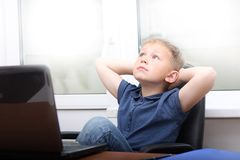Young boy  near laptop. Royalty Free Stock Image