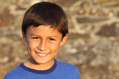 Young boy near sunset by an old wall Royalty Free Stock Photography
