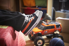 Young boy with new trainers on bed Royalty Free Stock Image