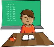 Young boy not enjoying making homework Stock Photography