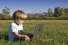 Young boy with notebook Royalty Free Stock Image
