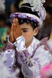 Young boy at novice ceremony, Myanmar. Young praying Burmese boy with traditional dress attending a Buddhist novice hood initiation ceremony in Bagan, Myanmar royalty free stock photo