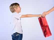 Young boy offer gift to woman Royalty Free Stock Photos
