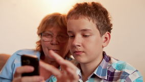Young Boy and Old Person Learn Smartphone Royalty Free Stock Image