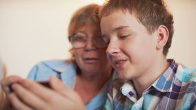 Young Boy and Old Person Learn Smartphone Stock Photo