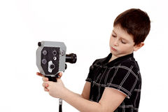 Young boy with old vintage analog 8mm camera Stock Photography
