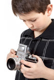 Young boy with old vintage analog SLR camera Royalty Free Stock Photography