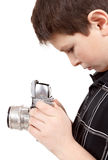 Young boy with old vintage analog SLR camera Stock Photo