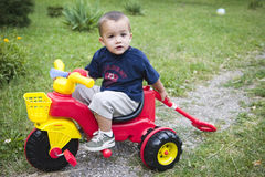 Young Boy On Toy Bike Stock Photo