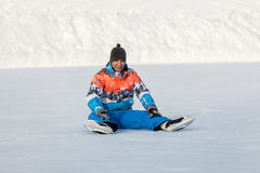 Young boy, one skate on the frozen lake Stock Image