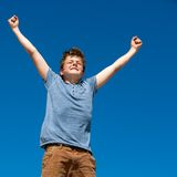Young boy with open arms outdoors. Close up portrait of young boy with open arms outdoors Royalty Free Stock Images