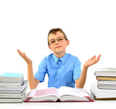 Young boy with open hands and books Royalty Free Stock Photo