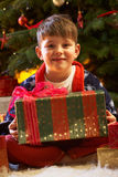 Young Boy Opening Christmas Present Stock Photo