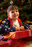 Young Boy Opening Christmas Presents Royalty Free Stock Photo