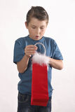 Young boy opening present stock photography
