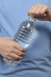 Young boy opening a water bottle Stock Image