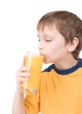 Young boy with orange juice Stock Photography