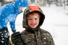 Young boy out in the snow. Stock Image