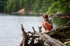 Young boy outdoors exploring Royalty Free Stock Image