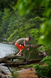Young boy outdoors exploring. Little boy outdoors at a lake exploring in the summer royalty free stock photo